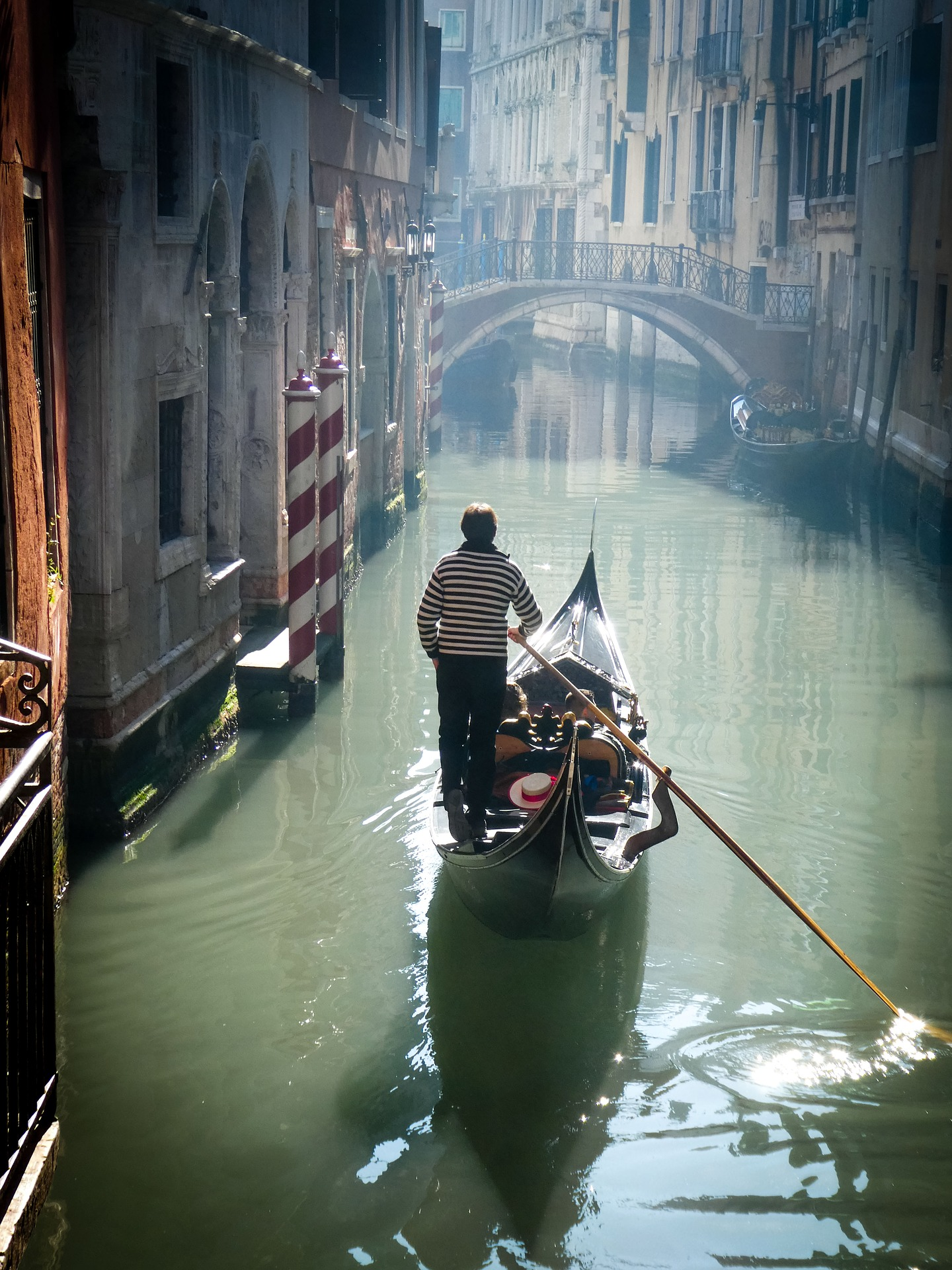 A gondola ride along narrow alleyways